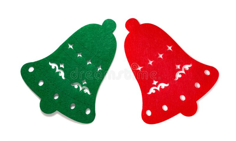 Christmas decoration of a green and red flat bells on white stock images