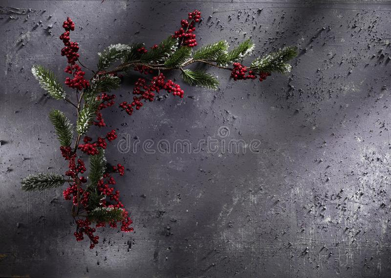 Christmas decoration on grey stone background. High-definition stillife photograpy dramatic light. shiny lightly object cone star green red gold golden royalty free stock photography