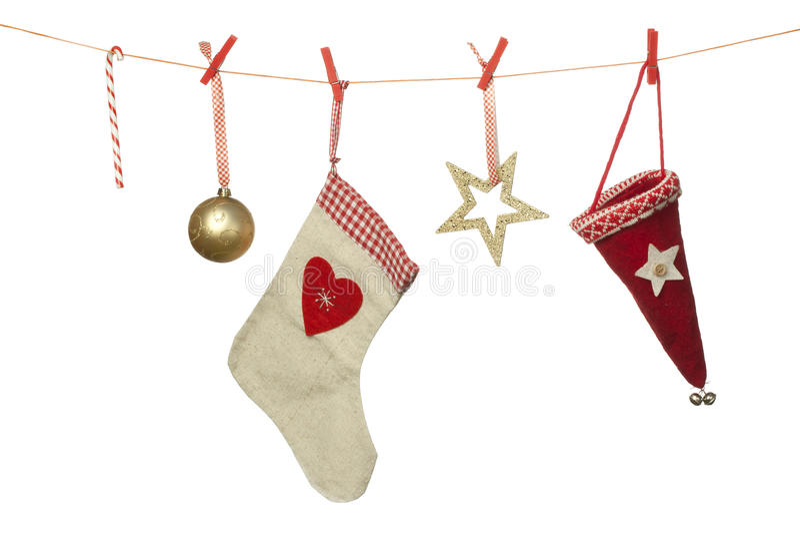 Christmas decoration, hat sphere sock candy cane hanging on washing line, isolated on white background royalty free stock photo