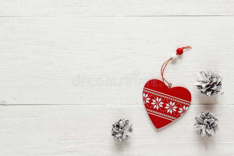 Christmas decoration heart and pine cones on white boards. Top v. Iew. Space for text stock photos