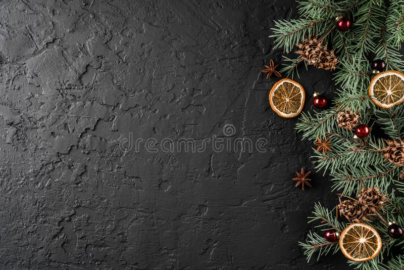 Christmas decoration on holiday background with Fir branches, pine cones, red decoration, spices. Xmas. And Happy New Year theme. Flat lay, top view, space for stock photo