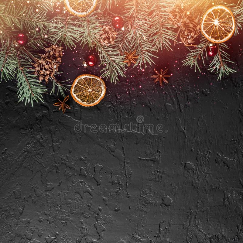 Christmas decoration on holiday background with Fir branches, pine cones. Xmas and Happy New Year theme, bokeh, sparking, glowing. Flat lay, top view, space stock photography