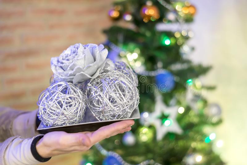 Woman holding christmas ball over lights background stock images