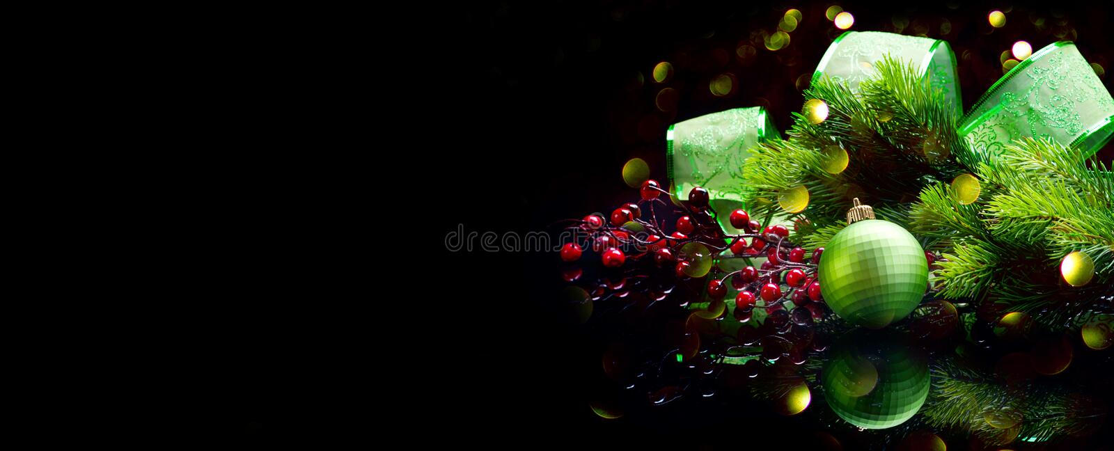 Christmas Decoration isolated on black. Wide screen backdrop. Border art design with holiday baubles stock photo