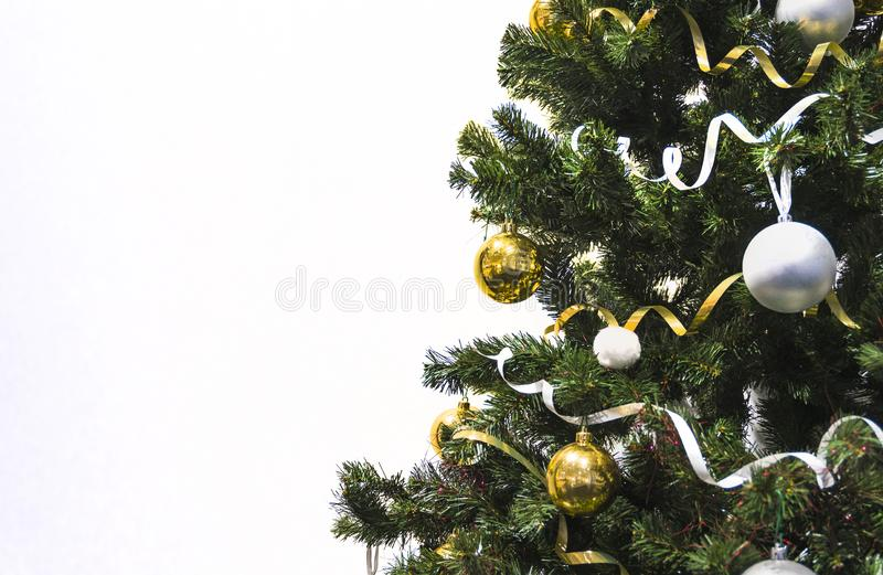 Christmas decoration. Isolated on white background. Christmas tree decorated with yellow and white balls and tinsel stock images