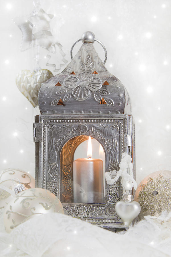 Christmas decoration with a latern in white and silver for a christmas card royalty free stock photography