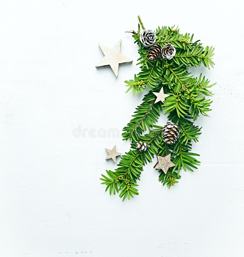 Christmas decoration made from fir twigs, cones and wooden stars. White background stock images
