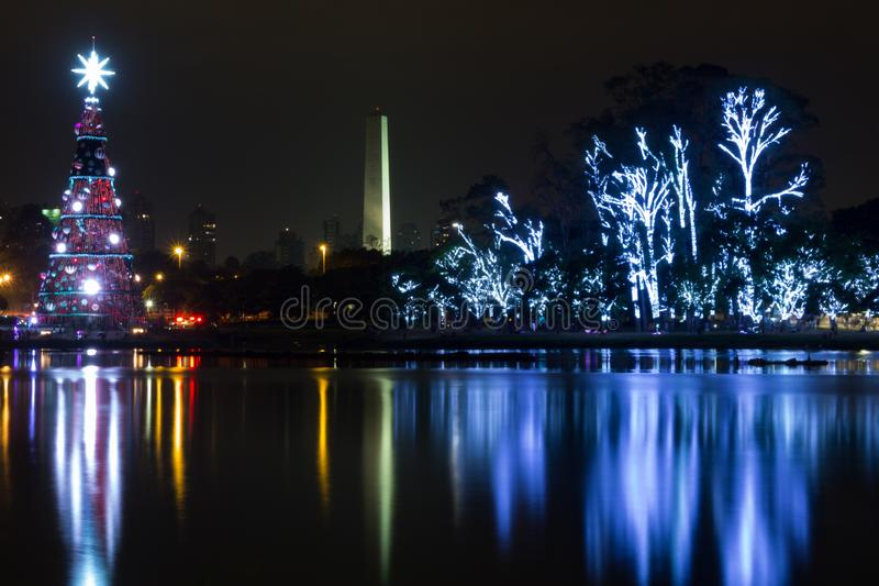 Christmas decoration and obelisk - sao paulo city. The most important park of sao paulo city, decorated for christmas. lake, trees, obelisk, colors stock images