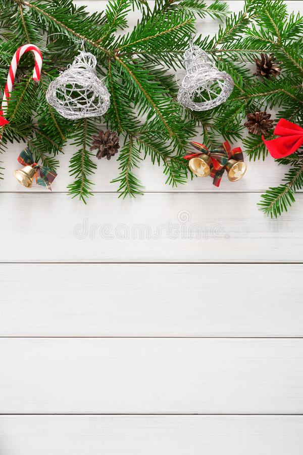 Christmas decoration, ornaments and garland frame background. Xmas decoration border background. Fir tree branches border with bells, candy canes and pine cones stock photography