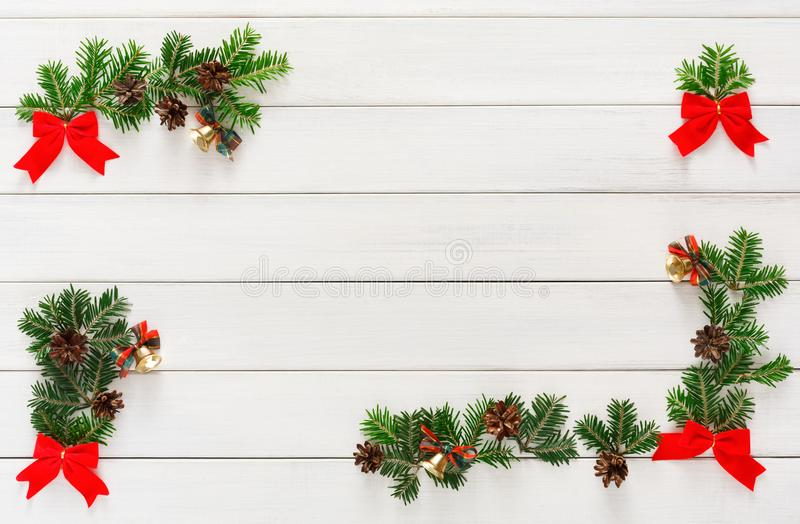 Christmas decoration, ornaments and garland frame background. Xmas decoration, garland frame concept background, top view with copy space on white wooden surface stock image