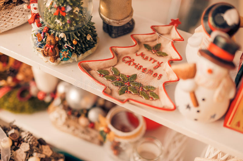 Christmas decoration. And ornaments on rustic wooden background. Retro style dark colored picture with light effects. Shallow depth of field stock photography