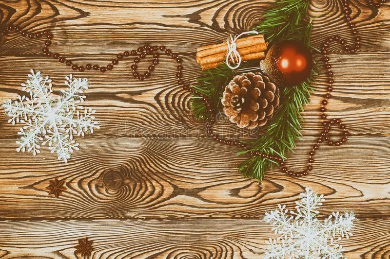 Christmas decoration over a wooden background, vintage toning. Flat lay, copy space. stock image