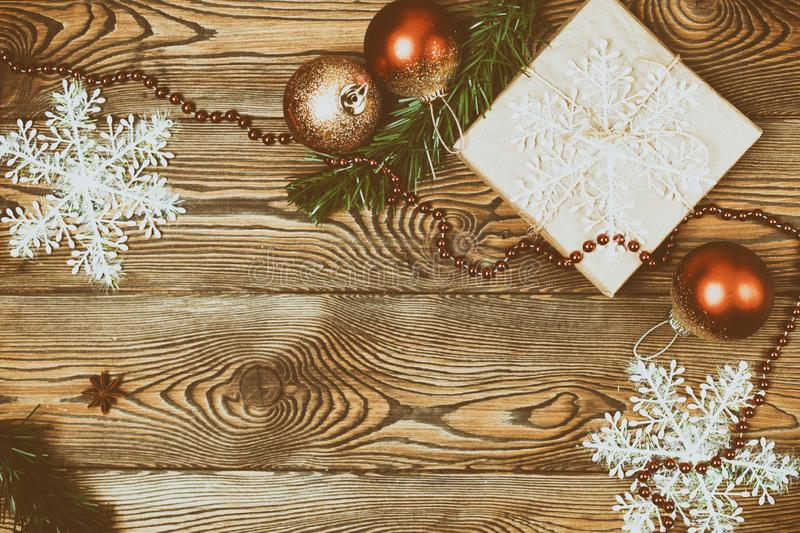 Christmas decoration over a wooden background, vintage toning. Flat lay, copy space. stock photography