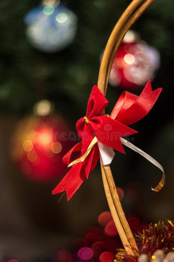 Christmas decoration - a red belt under the Christmas tree. Beautiful red ribbon in the form of a bow. Decoration for New Year holidays. On the background are royalty free stock photography