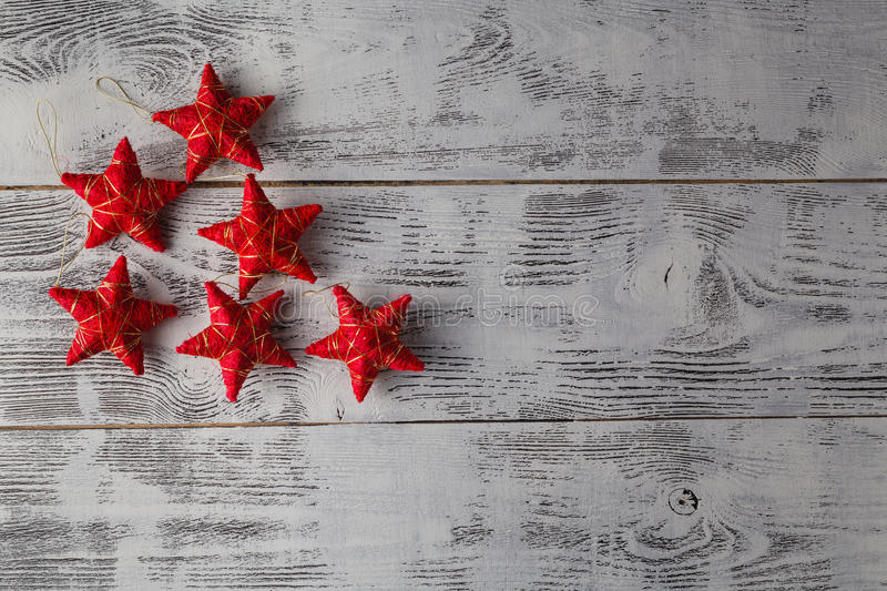 Christmas decoration.Red Christmas stars on rustic dark wooden b royalty free stock photography