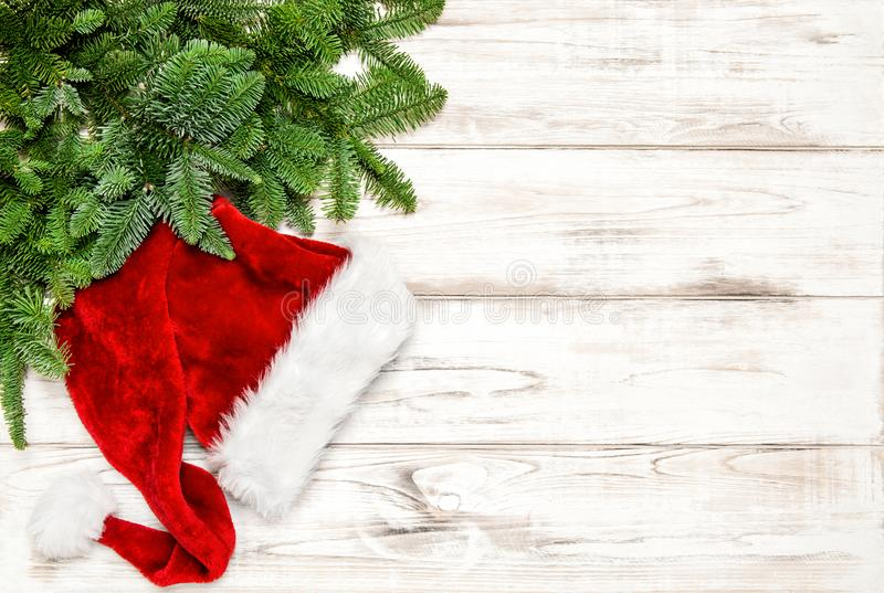 Christmas decoration red Santa hat green pine tree branches royalty free stock image