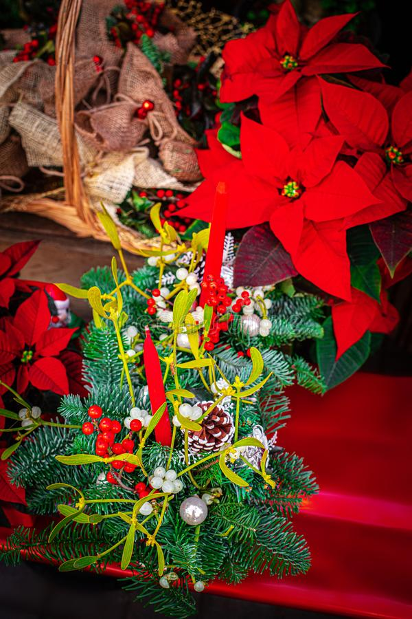 Christmas decoration with red star flower  Poinsettia, fir tree, candles and balls on a Christmas Market stock images