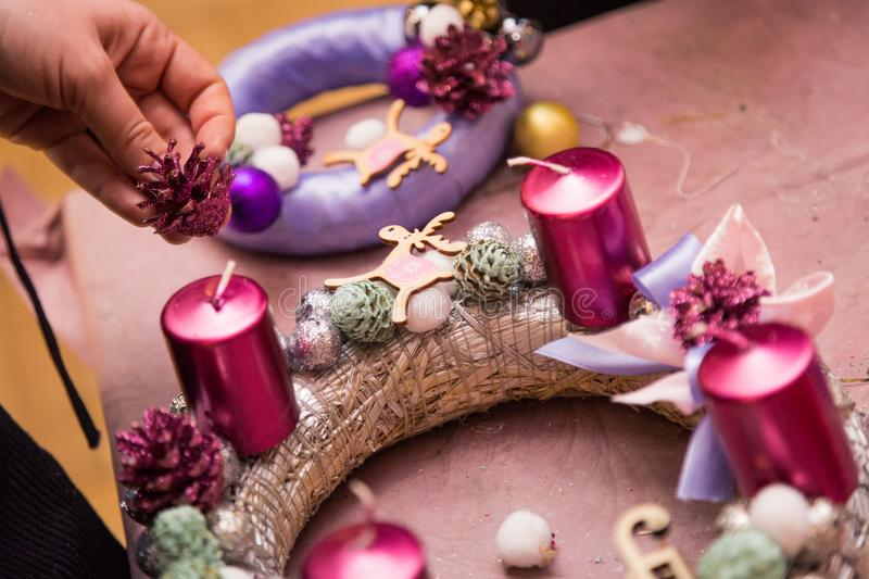 Christmas decoration round wreath pink colors with candles stock photos