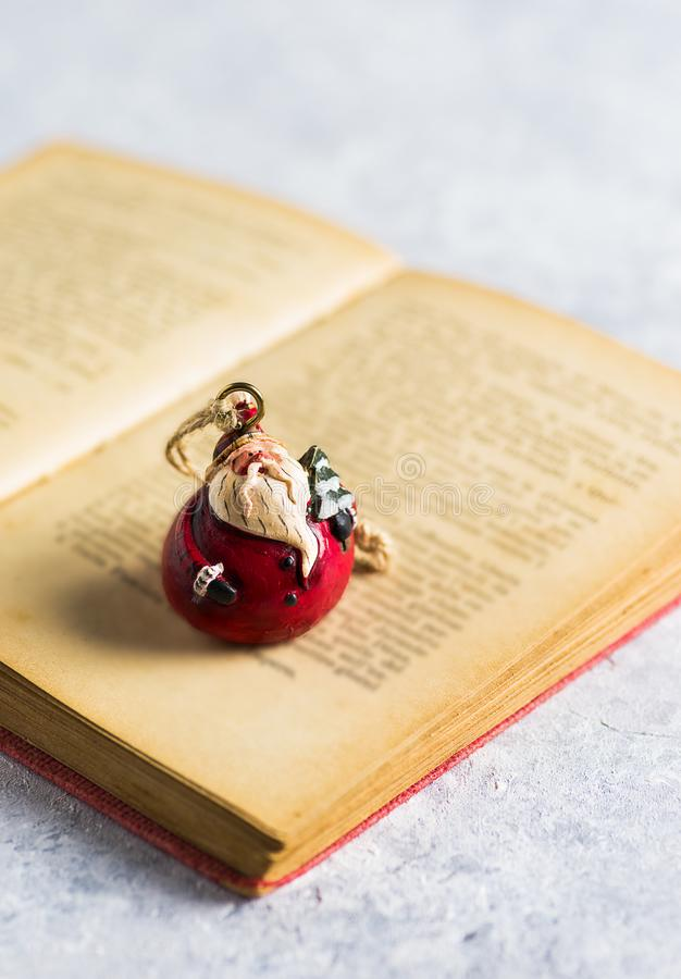 Christmas decoration, `Santa Claus` on a open book. `Santa Claus` on a open and old book stock photos