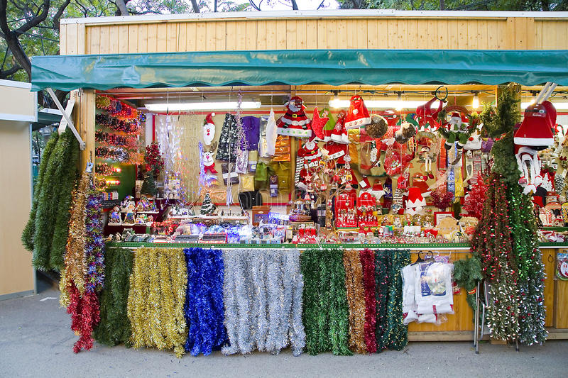 Christmas decoration shop. BARCELONA, SPAIN - DECEMBER 1: Shop at the famous Santa Llucia Fair, where people buy Christmas decoration, as fir trees and crib royalty free stock photo