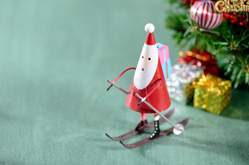 Christmas decoration, skating santa claus. On green background royalty free stock images