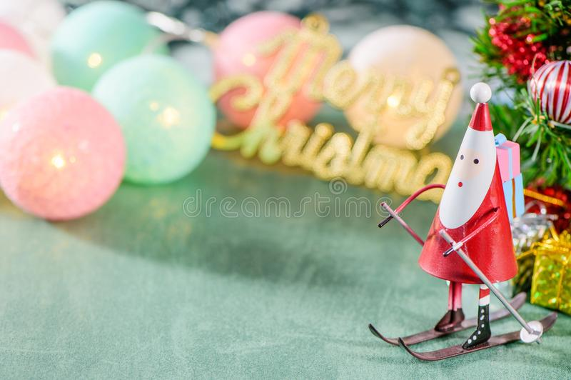 Christmas decoration, skating santa claus with christmas english character and Christmas imagery. On green background royalty free stock photos
