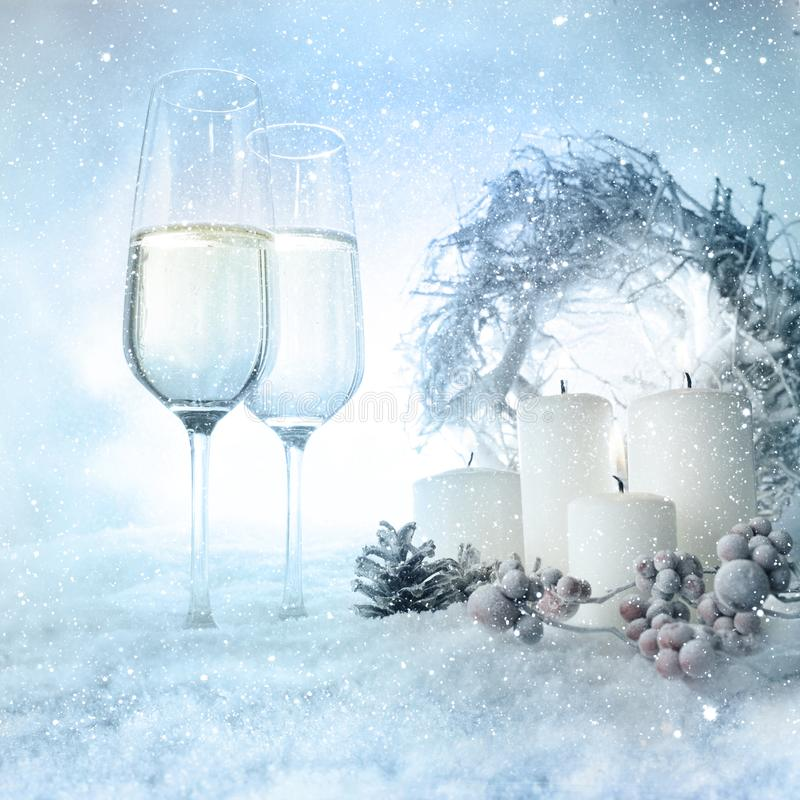 Christmas decoration in snow with champage stock photography