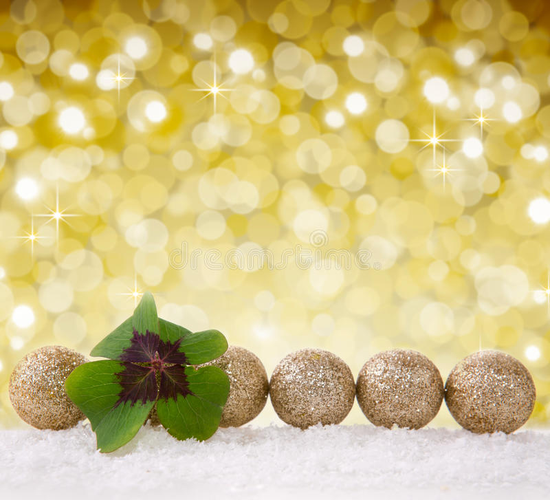 Christmas decoration with snow and cloverleaf. Christmas decoration with snow isolated on bokeh background.Defocused bokeh lights.Lucky symbols: four-leaf stock image