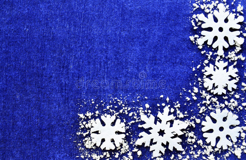 Christmas decoration.Snowflakes border on blue background with copyspace.Christmas snowflakes.Christmas border. stock photography