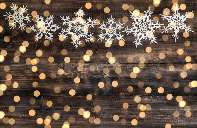 Christmas decoration snowflakes and defocused lights stock photos
