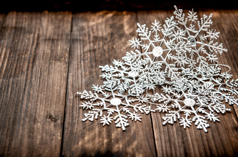 Christmas decoration snowflakes rustic wooden background royalty free stock photography