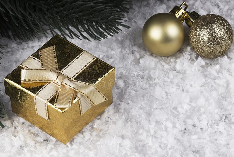 Christmas decoration with snowlakes golden gift box and Christmas balls. stock photo