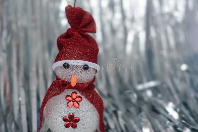 Christmas Decoration snowman on shiny silver christmas paper close up. Art Christmas Greeting Card royalty free stock photography