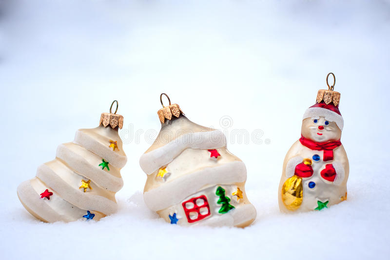 Christmas decoration. Some Christmas decorations in the snow background stock photography