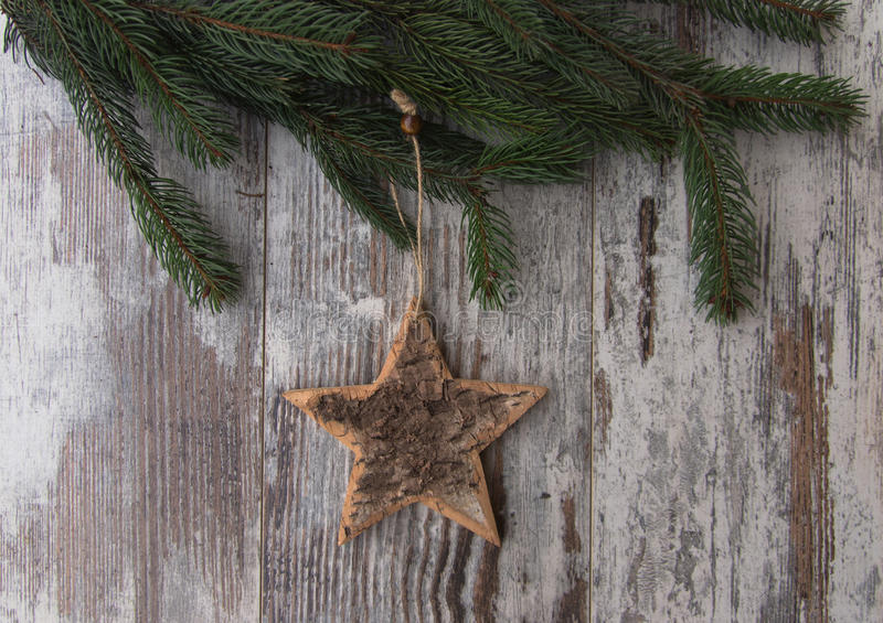 Christmas decoration, star, and conifer of fir tree on textured. Christmas decoration on wood background stock photo