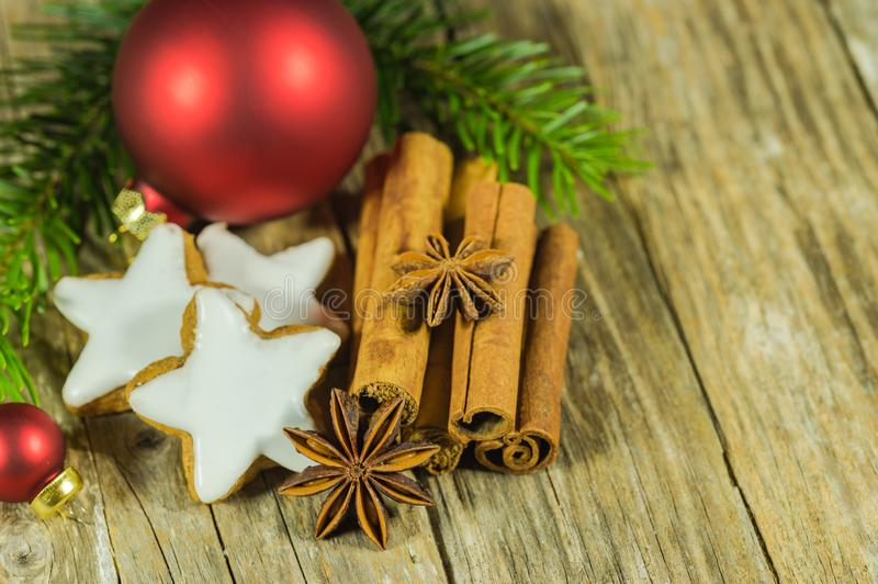 Christmas star shaped biscuits and spices on wooden table royalty free stock photos