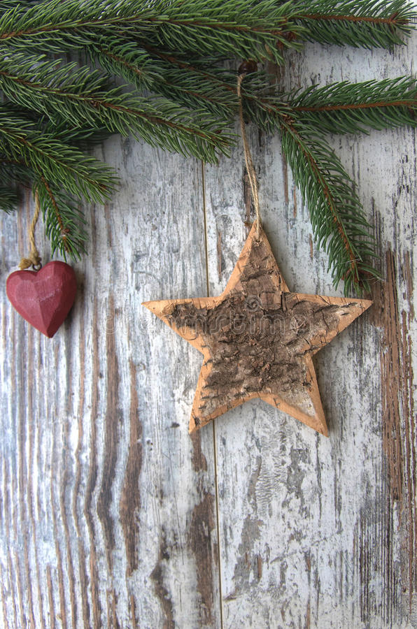 Christmas decoration, star - heart - conifer - fir - tree extured wood. Christmas decoration on wood background royalty free stock images