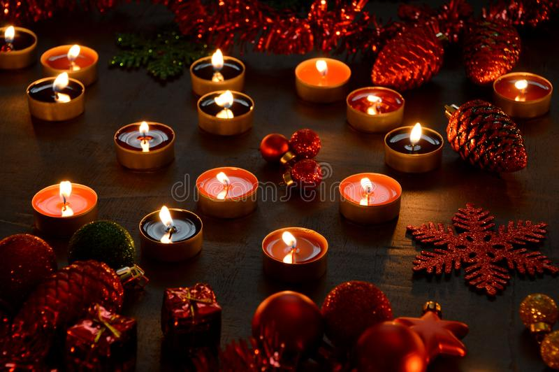Christmas decoration tealight candles and christmas ornaments. Christmas decoration burning tealight candles and christmas ornaments royalty free stock images