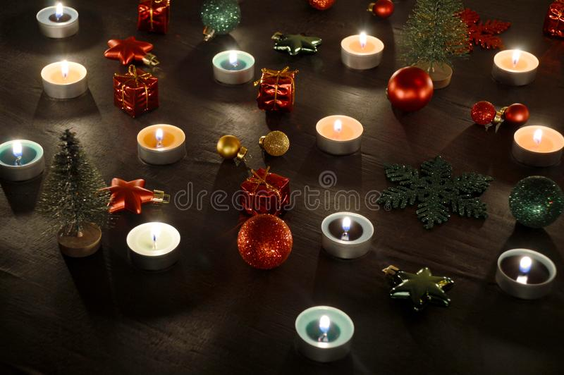 Christmas decoration tealight candles and christmas ornaments. Christmas decoration burning tealight candles and christmas ornaments royalty free stock image