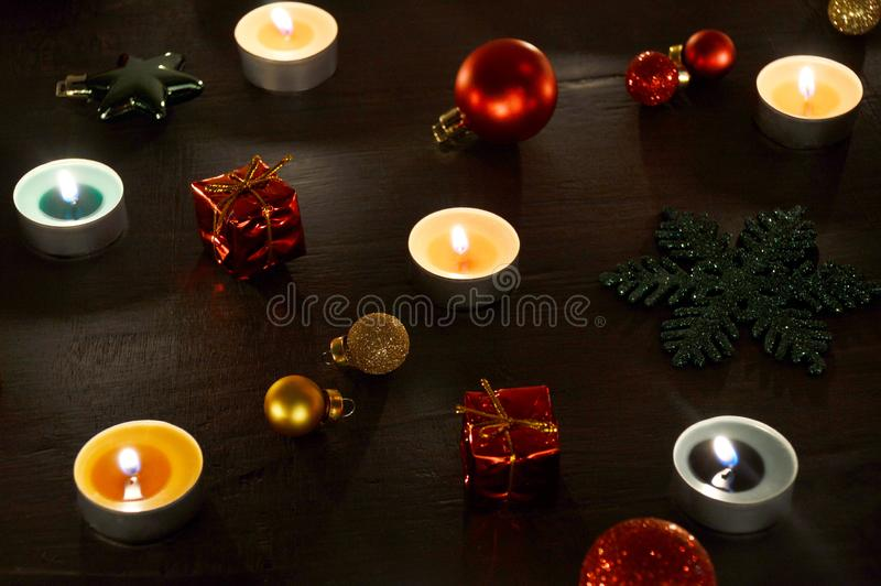 Christmas decoration tealight candles and christmas ornaments. Christmas decoration burning tealight candles and christmas ornaments stock images