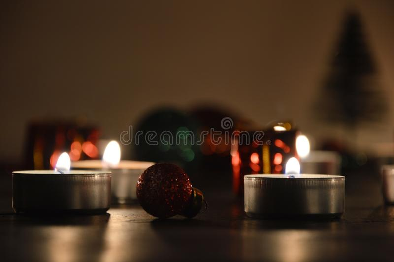 Christmas decoration tealight candles and christmas ornaments. Christmas decoration burning tealight candles and christmas ornaments stock photo
