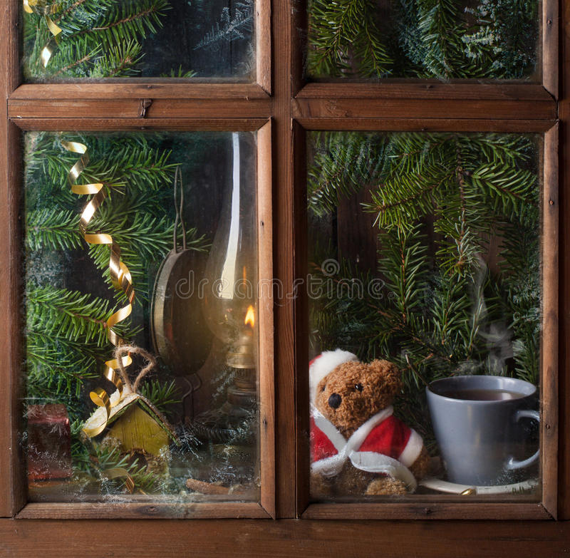 Christmas decoration with teddy bear in window stock image