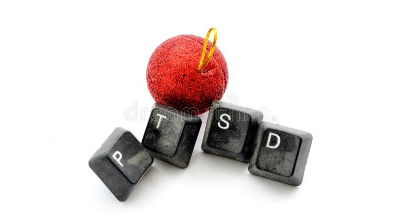 christmas decoration and text ptsd with old dirty computer buttons on white background, image royalty free stock photos