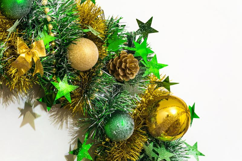 Christmas decoration of tinsel, bows, balls, beads, cones and stars stock photos