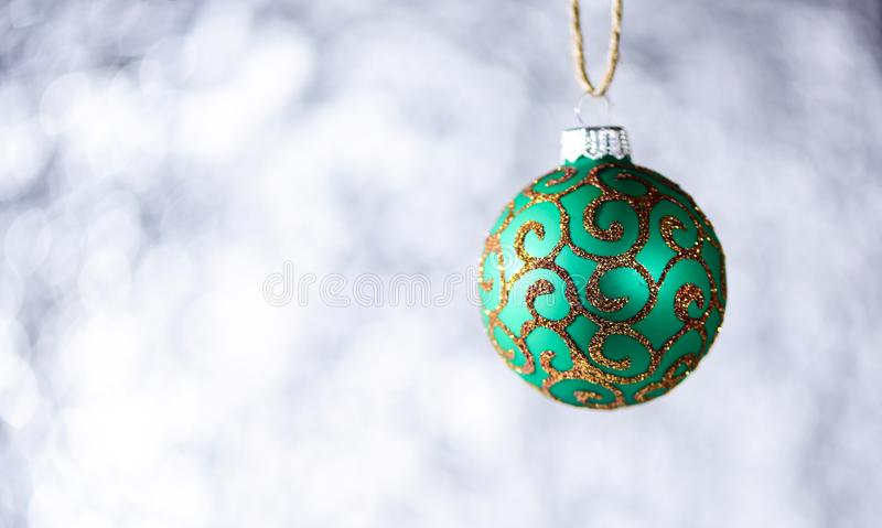 Christmas decoration or toy for Christmas tree with shimmering details, copy space. Decoration concept. Festive ornament royalty free stock photo
