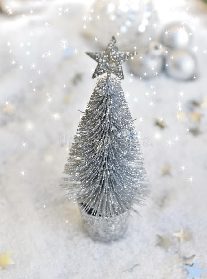 Christmas decoration on lights and snow. Little christmas tree decoration in lights and snow backgroundn royalty free stock photos