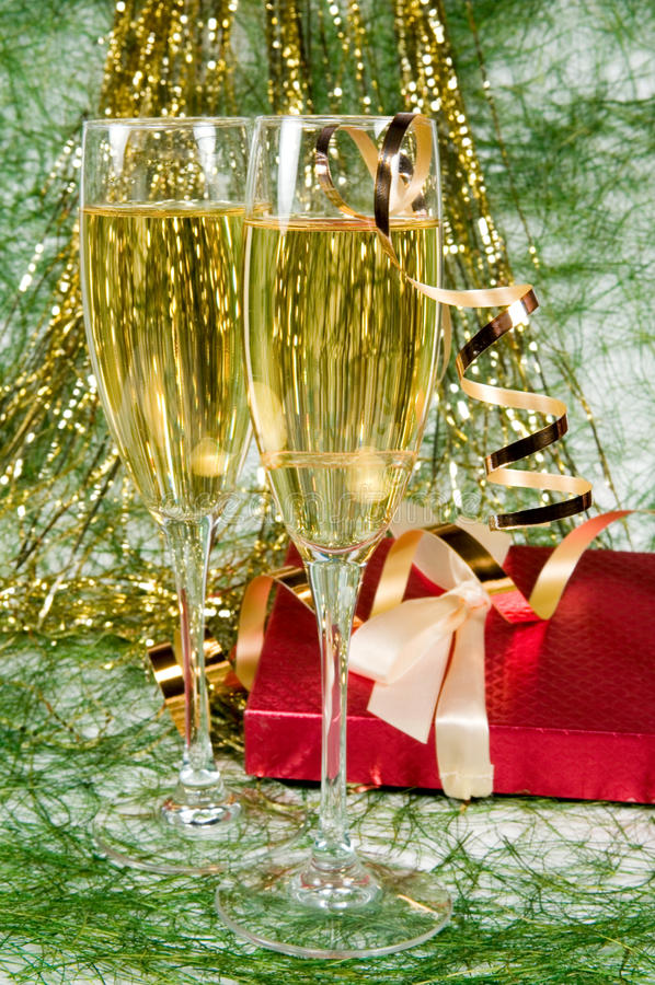 Christmas decoration and two glasses of champagne stock photography