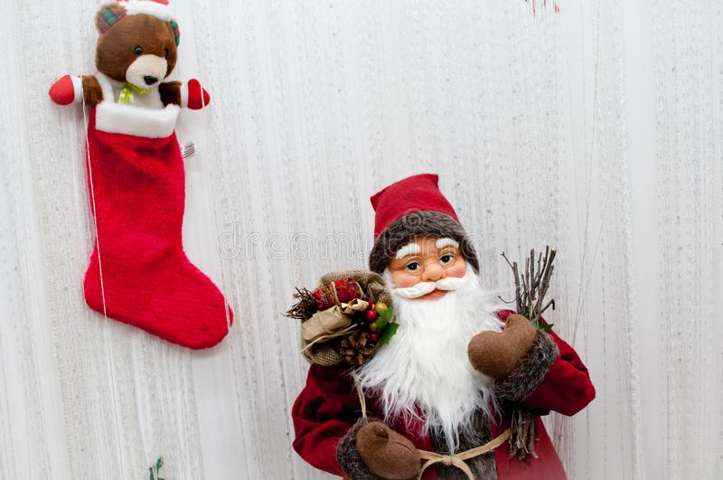 Christmas decoration vintage Santa Claus with gifts. And cute little teddy bear in red sock royalty free stock image