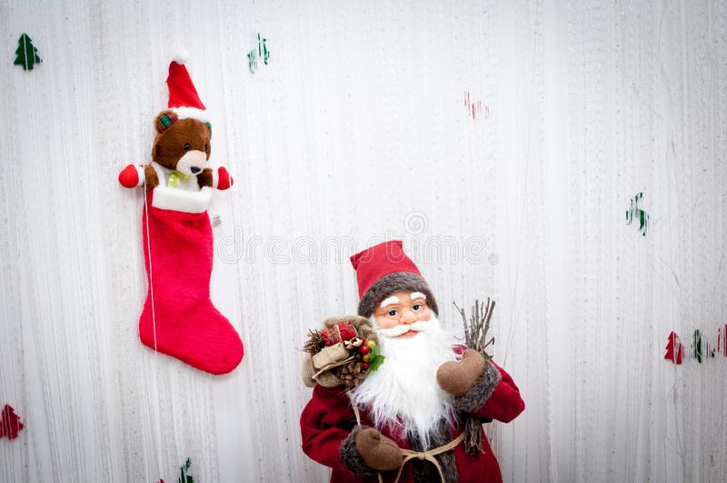 Christmas decoration vintage Santa Claus with gifts. And cute little teddy bear in red sock royalty free stock photo