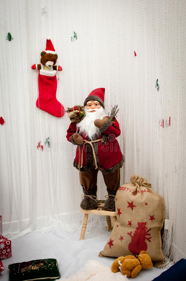 Christmas decoration vintage Santa Claus with gifts. And cute little teddy bear in red sock royalty free stock photography